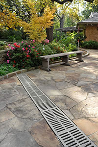 Residential and commercial patio and decks channel drains grates to facilitate the drainage to prevent the ponding water in your Fort Worth Texas landscape