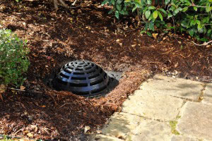 Residential and commercial landscape rain water drainage systems using catch basin where ponding water occurs in the San Antonio Texas area
